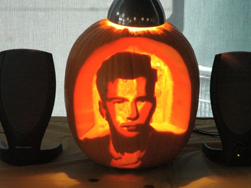 The face of Rick Astley, on a pumpkin